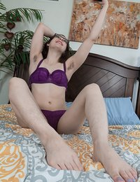 Ember Stone is laying in bed in her purple lingerie. she shows off her hairy pits and strips nude to show off more. She has a sexy hairy pussy and masturbates to orgasm showing it off for us.