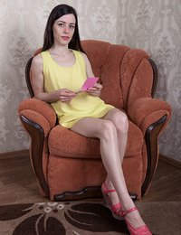 We see Maria Rosa relaxing in her orange armchair, showing off her body. The yellow dress slides off and she shows her hairy pussy to everyone. She touches her pussy and breasts all over and has fun.