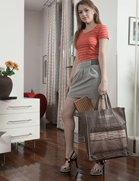 In her living room, Kira Tomson shows off her body in her orange top and grey skirt. She strips it all off, and lays back with legs open. There, she masturbates and fingers her hairy bush to pleasure.