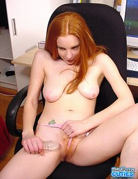 Busty Redhead Teen Sitting Naked in an Armchair of Her Daddy at the Office Touching Her Hairy Pussy and Rubbing Clit