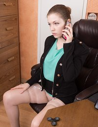 Apricot Pitts is finishing a call in her office and eager to strip naked. She strips off her blouse, panties, and clothes on her leather chair, and shows the camera her hairy pits, and hairy pussy.