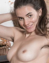 Natalia is in all black but slowly takes off her bra and thong to show off her body. She has hairy pits, 34C natural breasts and a hot hairy bush. She touches her body all over and smiles feeling sexy.